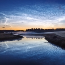 Noctilucent clouds over the river, Finland, 2009